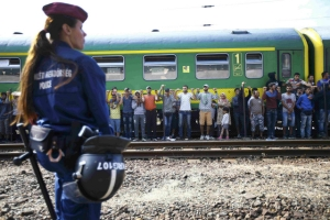 Migrants stage a protest in front of the Bicske railway station in Bicske