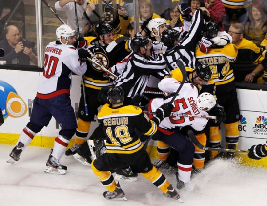 Capitals players tangle with Bruins players after a whistle in Game 2 of their NHL Eastern Conference quarter-final hockey playoff series in Boston
